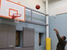 Harlee Miller shoots a basketball.