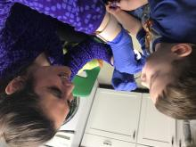 Dental hygienist looking in the mouth of a child