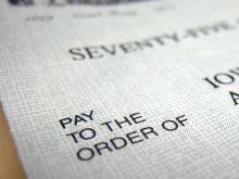 """Pay to the Order of"" printed on the front of a check."