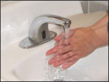 Wet hands under faucet