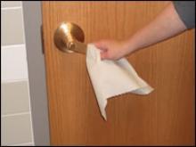 Open door handle with paper towel