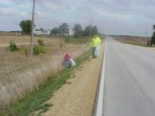 A few volunteers cleaning up along the roadway.