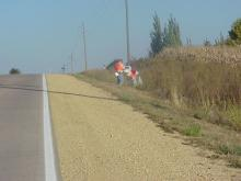 Adopt a Road cleanup volunteer in the ditch along the road.