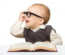 This is a picture of a baby with a book