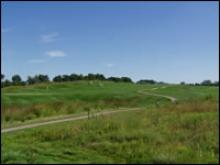The rolling hills of the golf course.