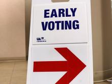 Sign with arrow that reads Early Voting.
