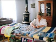 Woman quilting.