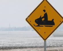 A roadside snowmobile sign.