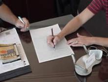 Filling out paperwork on a desktop.