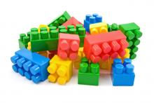 This is a picture of multi-colored LEGOs in a pile.