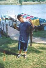 photo of a Kid with a big fish