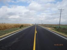 A newly paved country side roadway.