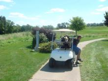 Photo of golf cart on course