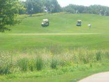 photo of golf carts on course