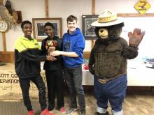 photo of chili cook off winners with smokey the bear