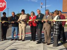 Board of Supervisors ribbon cutting sidewalk construction dedication.