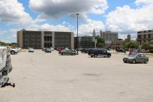 The Scott County Courthouse parking lot with a spattering of cars.