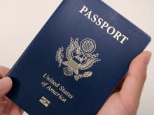 Holding a US Passport.