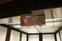 Elevator down arrow indicator.