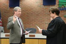 Swearing in Attorney Michael Walton.