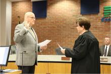 Swearing in Supervisor Ken Croken.