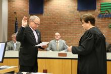 Swearing in Supervisor Brinson L. Kinzer.