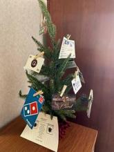 Small Christmas tree with attached gift cards.