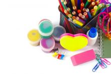 A group of craft supplies, including paint, colored pencils, and stationery.