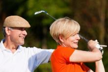couple with a golf club