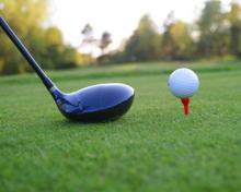 photo of a golf club and a ball on a tee