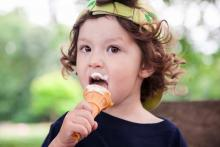 photo of child eating an ice cream cone