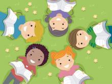 Children reading books in a field