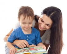 This is an adult and child with a book