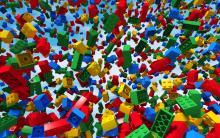LEGO bricks falling from a blue sky.