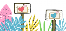 Signposts with hearts, placed among various colored plants.