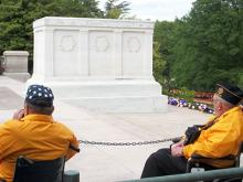 Honor flight veterans at a memorial in Washington DC.