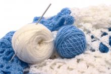 This is a picture of balls of yarn and knitting needles