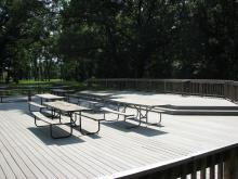 Outdoor patio area with picnic tables.