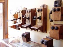 A bank of antique telephones.