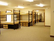 Large room with sets of bunk beds.