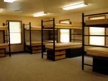 large room with many sets of bunk beds.