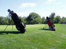 Set of golf bags.