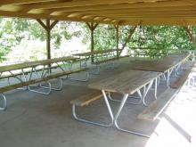 Picnis tables inside Cody Lake shelter.