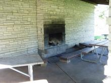 Closer view of the fireplace and bench seating at Sac-Fox Campground.