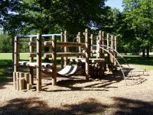 Playground equipment located near the shelter.
