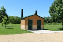 Restrooms located near the shelter.