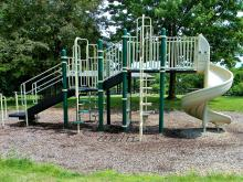 Playground equipment conveniently located near the shelter.