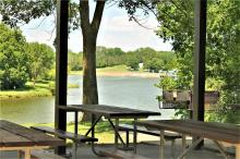 View of the lake from inside the picnic shelter.