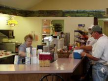 Customer ordering food from concession area.