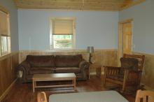 Interior living room area of Kestrel cabin.